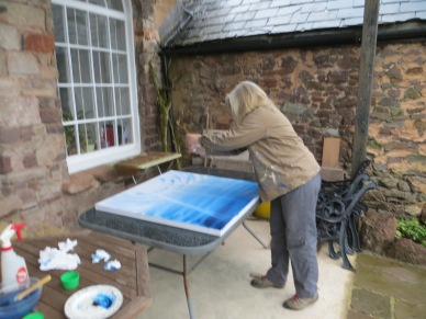 Sue Searle painting in the garden